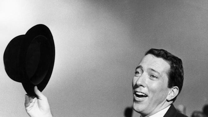 """FILE - In a May 12, 1961 file photo, Andy Williams performs a song on a television show. Emmy-winning TV host and """"Moon River"""" crooner Williams died Tuesday night, Sept, 25, 2012 at his home in Branson, Mo., following a year-long battle with bladder cancer. He was 84. (AP Photo, File)"""