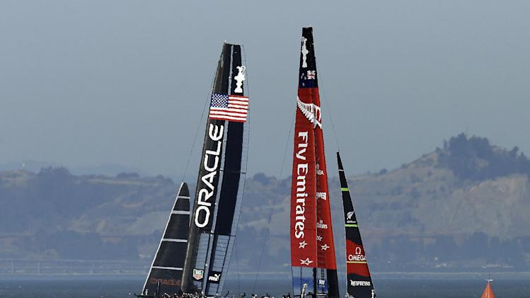 Oracle Team USA, left, leads Emirates Team New Zealand during the 12th race of the America's Cup sailing event, Thursday, Sept. 19, 2013, in San Francisco. (AP Photo/Ben Margot)
