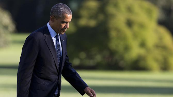 President Barack Obama arrives on the South Lawn of the White House on Friday, Sept. 20, 2013 in Washington. Obama traveled to a Ford plant in Liberty, Mo., to promote his economic policies. (AP Photo/ Evan Vucci)