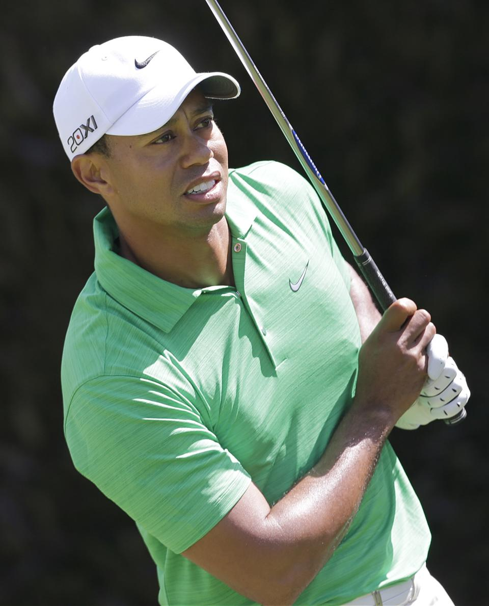 Tiger Woods watches his drive on the first tee during the third round of the U.S. Open Championship golf tournament Saturday, June 16, 2012, at The Olympic Club in San Francisco. (AP Photo/Eric Gay)