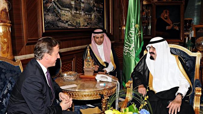 In this photo releases by the Saudi Press Agency, British Prime Minister David Cameron, left, meets with Saudi Arabia's King Abdullah, right, in Jiddah, Saudi Arabia, Tuesday, Nov. 6, 2012. British Prime Minister David Cameron suggested Tuesday that Syria's president Bashar Assad could be allowed safe passage out of the country if that option would guarantee an end to the nation's civil war. (AP Photo/Saudi Press Agency)