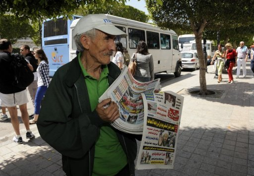 A newspaper vendor stands on Habib Bourguiba Avenue in May 2012 in Tunis. Amnesty International voiced fears on Wednesday over restrictions on press freedom in Tunisia, where a blogger and critic of the government was detained