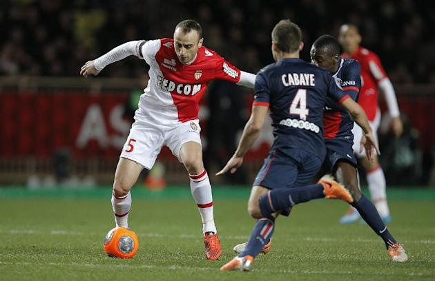 Monaco's Dimitar Berbatov of Bulgaria challenges for the ball with Paris Saint Germain's Yohan cabaye of France during their French League One soccer match, in Monaco stadium, Sunday, Feb. 9 ,