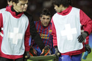 Spain's FC Barcelona forward David Villa, center, is carried on a stretcher after his injury after his goal attempt against Qatar's Al-Sadd Sports Club during the semifinal at the Club World Cup soccer tournament, in Yokohama, near Tokyo, Japan, Thursday, Dec. 15, 2011. (AP Photo/Shizuo Kambayashi)