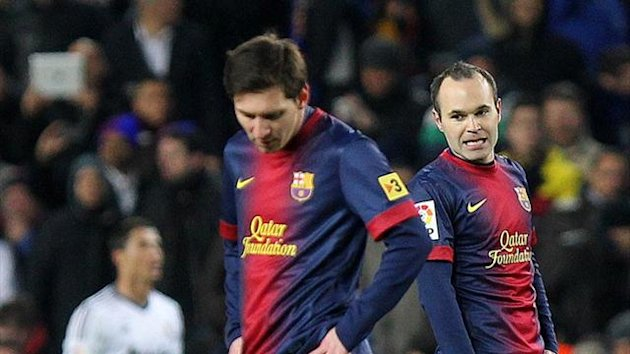 Barcelona forward Lionel Messi (L) and midfielder Andres Iniesta (R) during the Copa del Rey semi-final second leg against Real Madrid (AFP)