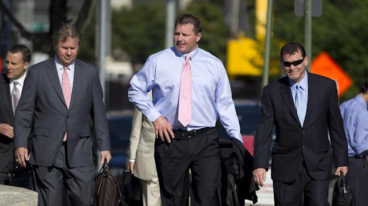 Former Major League Baseball pitcher Roger Clemens, center, arrives at federal court  in Washington, Tuesday, May 29, 2012, for his perjury trial.  (AP Photo/Evan Vucci)