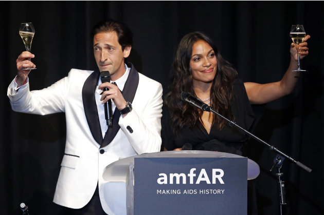 Actor Brody and actress Dawson attend an auction at the amfAR's Cinema Against AIDS 2013 event in Antibes during the 66th Cannes Film Festival