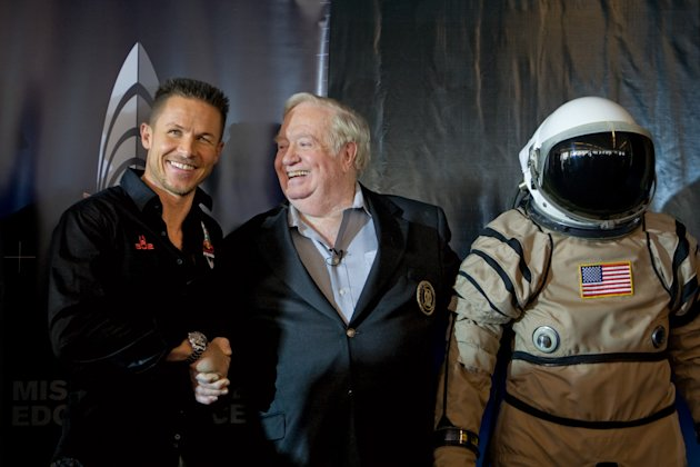In this Friday Jan. 22, 2010 photo taken by AP Images for Red Bull Stratos, Felix Baumgartner, left, shakes hands with United States Air Force Col. (Ret.) Joe Kittinger, right, following the Red Bull