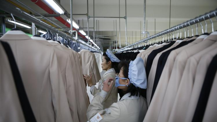 North Korean employees check finished products in a factory of a South Korean company at the Joint Industrial Park in Kaesong industrial zone