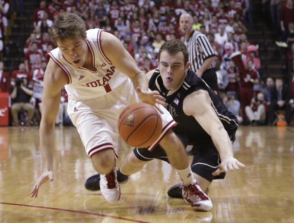 Indiana guard Jordan Hulls, left, and Purdue guard D.J. Byrd go for a loose ball in the first half of a NCAA college basketball game in Bloomington, Ind., Saturday, Feb. 16, 2013. (AP Photo/Michael Conroy)