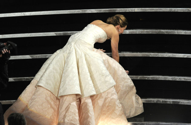 Jennifer Lawrence stumbles as she walks on stage to accept the award for best actress in a leading role for &quot;Silver Linings Playbook&quot; during the Oscars at the Dolby Theatre on Sunday Feb. 24, 2013, in Los Angeles. (Photo by Chris Pizzello/Invision/AP)