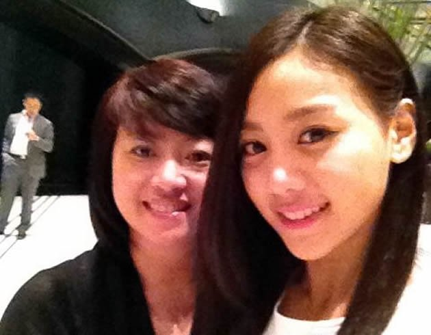 Tasha, leader of new K-pop group SKarf, poses for a quick photograph with her mother Lucy during the band's debut in Korea in August. (Photo courtesy of Lucy Wang)