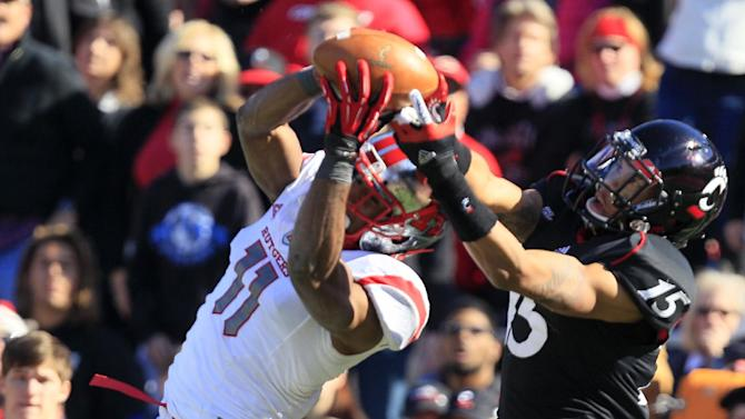 Rutgers defensive back Logan Ryan (11) intercepts a pass intended for Cincinnati wide receiver Chris Moore (15) in the first half of an NCAA college football game, Saturday, Nov. 17, 2012, in Cincinnati. (AP Photo/Al Behrman)