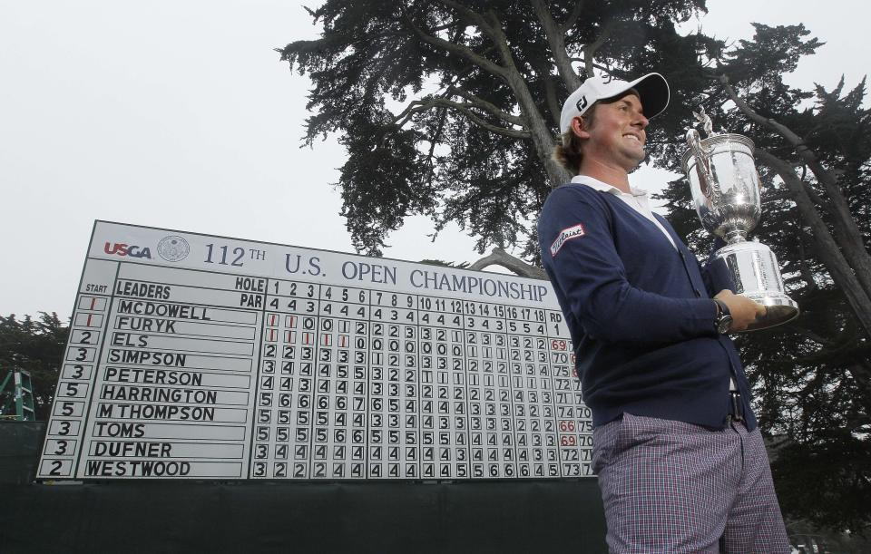 Webb Simpson posses with the championship trophy after the U.S. Open Championship golf tournament Sunday, June 17, 2012, at The Olympic Club in San Francisco. (AP Photo/Charlie Riedel)