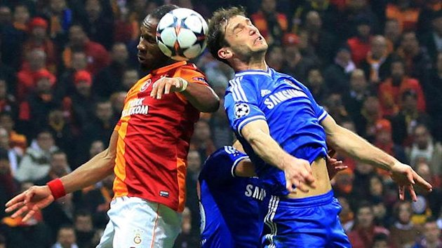 Galatasaray's Ivorian forward Didier Drogba (L) jumps for the ball with Chelsea's Branislav Ivanovic (Getty Images)
