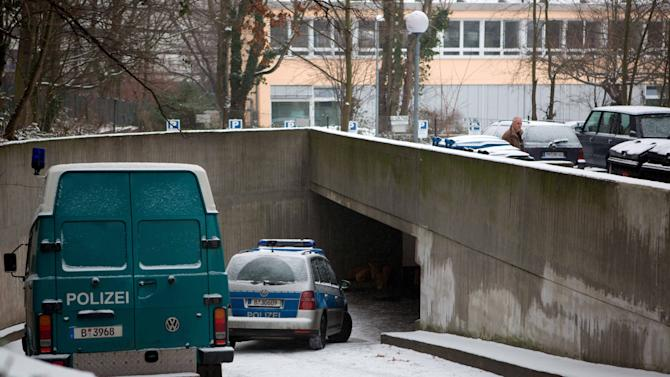 """Police cars stand at the entrance of an underground parking lot in Berlin Monday Jan. 14, 2013. German police say a 30-meter (100-foot) tunnel dug by robbers who raided a Berlin bank was """"very professional"""" and must have taken weeks or even months to complete.  Berlin police spokesman Thomas Neuendorf says the tunnel led from the underground garage beneath a green space into the bank's safe deposit room.  Neuendorf told The Associated Press on Monday that the tunnel was elaborately constructed and even had ceiling supports to stop it collapsing.   Police are still trying to determine what valuables were stolen from the deposit boxes. (AP Photo/dapd/ Tobias Koch)"""