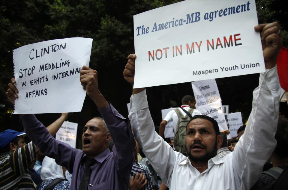 Egyptians chant anti-American slogans as they protest what they believe is American support for the Muslim Brotherhood in front of the U.S. embassy in Cairo, Egypt, Saturday, July 14, 2012.(AP Photo/Khalil Hamra)