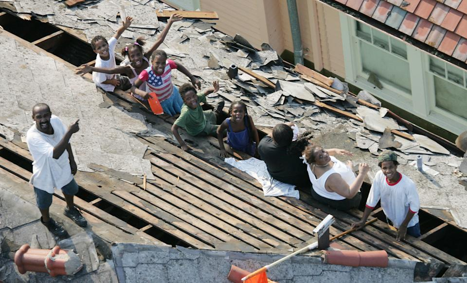 New Orleans residents wait to be rescued from the floodwaters of  Hurricane Katrina Wednesday, Aug. 31, 2005 in New Orleans.  After Sept. 11, the TV event with the most impact was the coverage of Hurricane Katrina in 2005. (AP Photo/David J. Phillip)