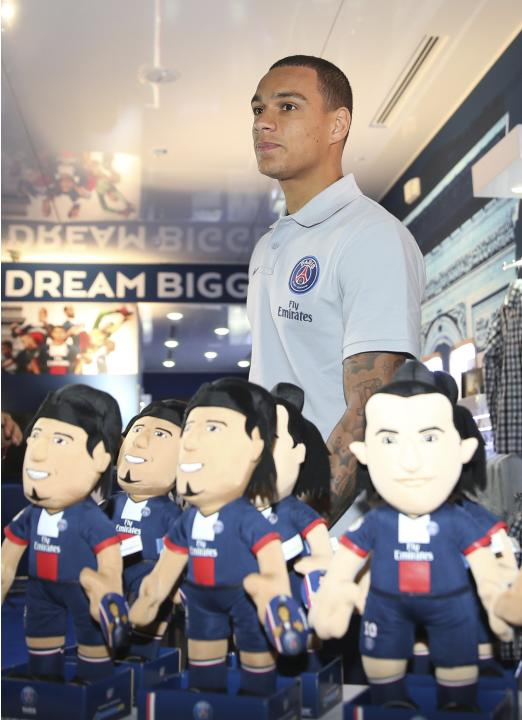 Paris Saint-Germain's Gregory van der Wiel attends the official opening of the PSG store at Villagio Mall in Doha