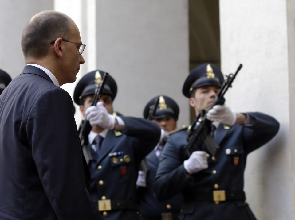 Italian policemen shot near new gov't swearing-in