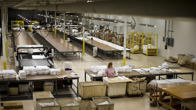 FILE - In this Monday, Oct. 15, 2012 file photo, Gloria Bambrick counts and stacks T-shirt components at FesslerUSA apparel manufacture in Orwigsburg, Pa. Superstorm Sandy depressed U.S. industrial output in October, while production of machinery and equipment declined sharply, reflecting a more cautious outlook among businesses, according to Federal Reserve reports, Friday, Nov. 16, 2012. (AP Photo/Matt Rourke, File)