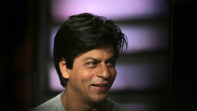 FILE - In this March 27, 2007 file photo, Bollywood superstar Shah Rukh Khan speaks during a press conference in Mumbai, India. Khan said he's finally fulfilled his dead father's wish and traveled to the Indian part of Kashmir to shoot his latest film in August 2012. The actor wrote on his Twitter account that his father wanted to take him to Kashmir because his mother was from there. (AP Photo/Rajesh Nirgude, File)