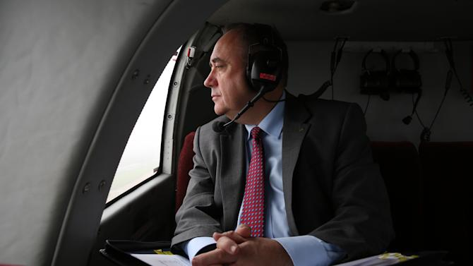 First Minister of Scotland Alex Salmond poses for a photograph as he flies from Aberdeen to Edinburgh