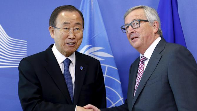 EU Commission President Juncker poses with U.N. Secretary-General Ban in Brussels