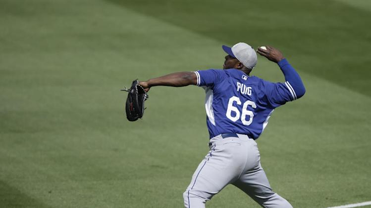 Los Angeles Dodgers right fielder Yasiel Puig in action during a spring exhibition baseball game against the Kansas City Royals Tuesday, March 11, 2014, in Surprise, Ariz. (AP Photo/Darron Cummings)