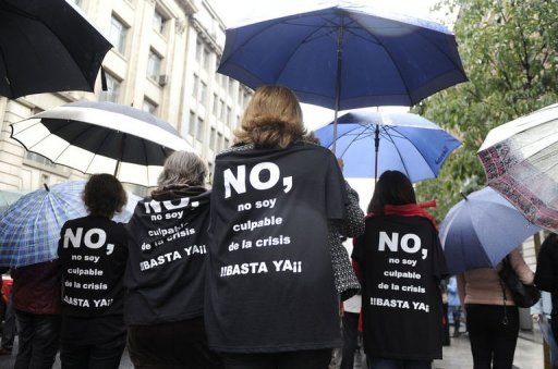 "<p>Spanish government employees with T-shirt slogans reading ""No, I am not guilty of the crisis, stop"" take part in a demonstration against the Spanish government's latest austerity measures. Spain's public debt is set to reach 85.3% of gross domestic product in 2012 and 90.5% in 2013, well above previous forecasts, according to figures in a draft budget submitted to parliament.</p>"