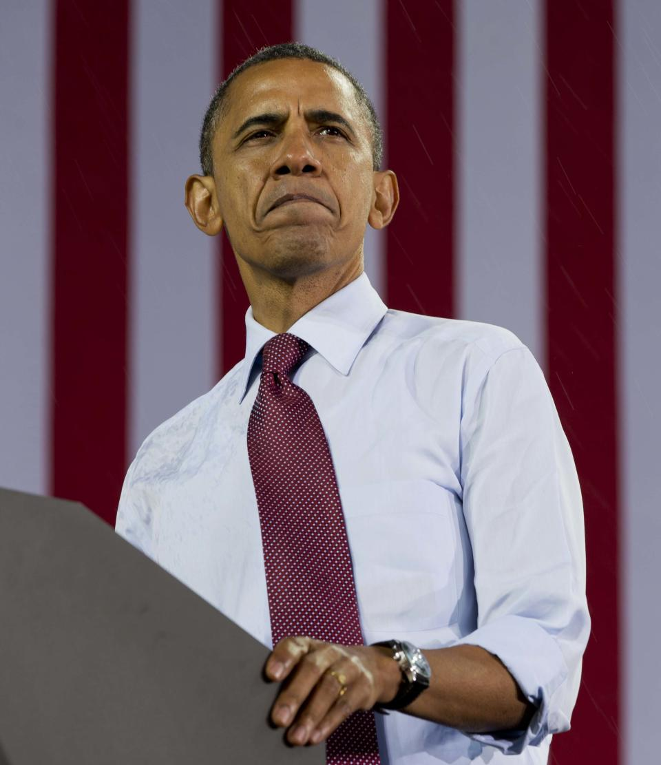 President Barack Obama pauses as he speaks at a campaign event at the Summerfest Grounds at Henry Maier Festival Park, Saturday, Sept. 22, 2012, in Milwaukee. (AP Photo/Carolyn Kaster)