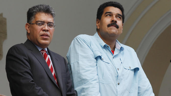 "Venezuela's President Nicolas Maduro, right, and Foreign Minister Elias Jaua, stand on the balcony of the Foreign Ministry after meeting with South Africa's foreign minister, in Caracas, Venezuela, Thursday, Sept. 19, 2013. Jaua said Thursday that the United States has prohibited a planned flight by Maduro from passing through U.S. airspace over Puerto Rico. The foreign minister said that the flight had been scheduled to pass over the U.S. territory on Friday on its way to China. He characterized the U.S. action as an ""aggression."" (AP Photo/Ariana Cubillos)"