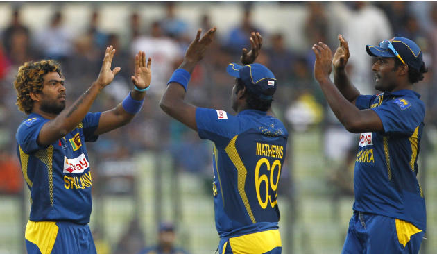 Sri Lanka's Lasith Malinga, left, celebrates with teammates the dismissal of Pakistan's Umar Akmal during their Asia Cup final cricket match in Dhaka, Bangladesh, Saturday, March 8, 2014. (AP Photo/A.