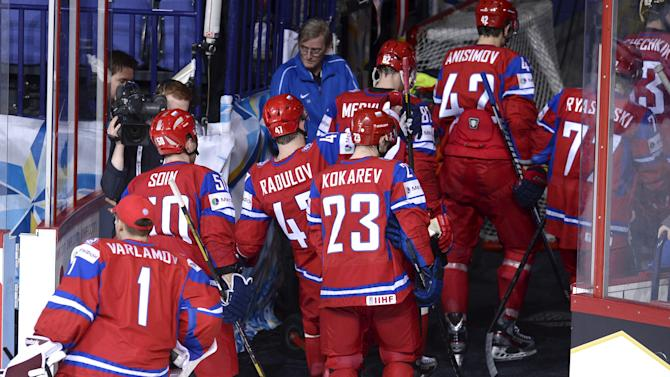 The losing Russian team leave after the 2013 Ice Hockey World Championships preliminary round match Russia vs France in Helsinki, Finland on Thursday,  May 9, 2013. France upset favourites Russia by winning 2-1.   (AP Photo / LEHTIKUVA / Heikki Saukkomaa)  FINLAND OUT