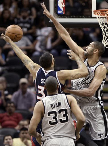 Duncan leads short-handed Spurs over Hawks, 99-97