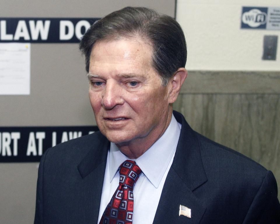 Former House Majority Leader Tom DeLay arrives at the Travis County courthouse in Austin, Texas on Tuesday, Oct. 26, 2010 for jury selection in his corruption trial. The 63-year-old DeLay is charged with money laundering and conspiracy to commit money laundering. (AP Photo/Jack Plunkett)
