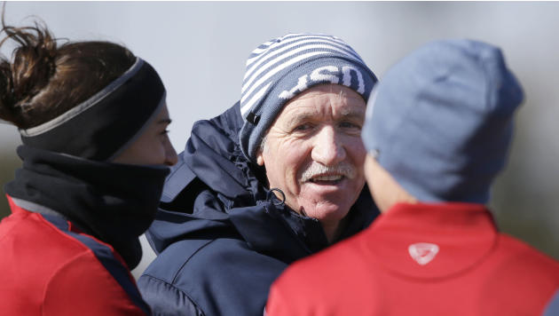 In this photo taken on Tuesday, Jan. 28, 2014, U.S. women's soccer head coach Tom Sermanni speaks to players during team practice in Frisco, Texas. Sermanni found out what a unique job it is to be