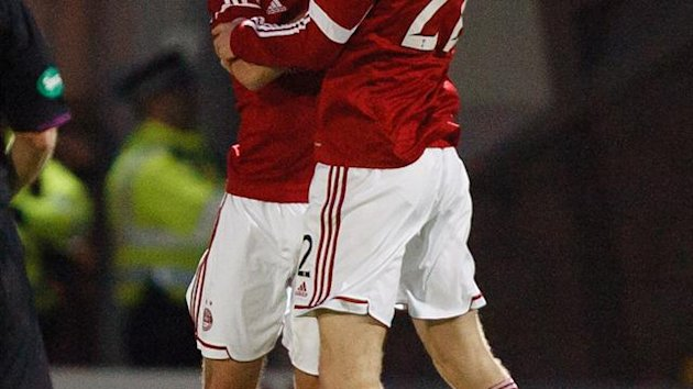 Niiall McGinn, left, was on target with two second-half goals for Aberdeen