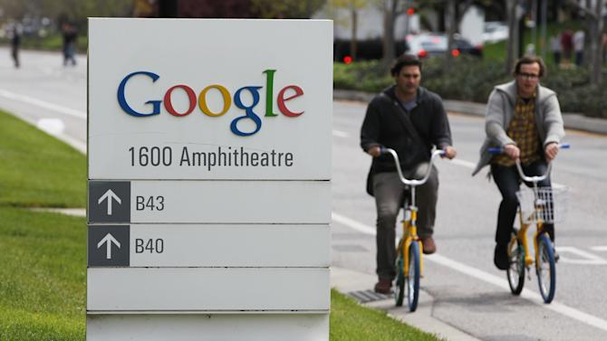 Google workers ride bikes outside of Google headquarters in Mountain View, Calif., Thursday, April 12, 2012. Google Inc. said Thursday that it earned $2.89 billion, or $8.75 per share, in the first quarter. That's up from $1.8 billion, or $5.51 per share, a year earlier. (AP Photo/Paul Sakuma)