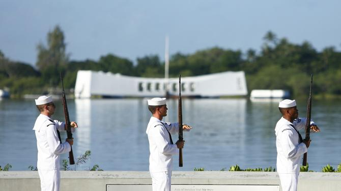 The US Navy Ceremonial Guard performs a rifle salute at the Arizona Memorial during the 72nd anniversary of the attack on Pearl Harbor at the WW II Valor in the Pacific National Monument in Honolulu