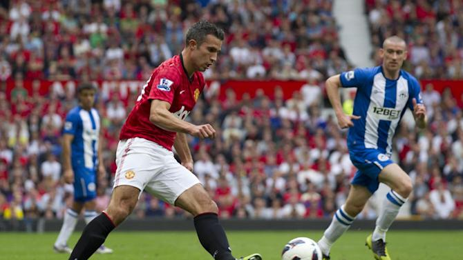 Manchester United's Robin van Persie, left, controls the ball past Wigan Athletic's David Jones during their English Premier League soccer match at Old Trafford Stadium, Manchester, England, Saturday, Sept. 15, 2012. (AP Photo/Jon Super)