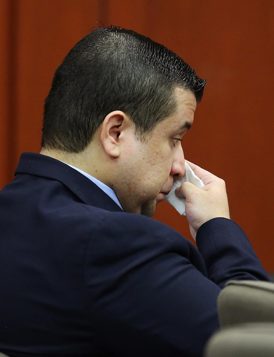George Zimmerman wipes his face after arriving in the courtroom during his trial at the Seminole County Criminal Justice Center, in Sanford, Fla., Friday, July 12, 2013. Zimmerman is charged in the 2012 shooting death of unarmed teenager Trayvon Martin. (AP Photo/Orlando Sentinel, Joe Burbank, Pool)