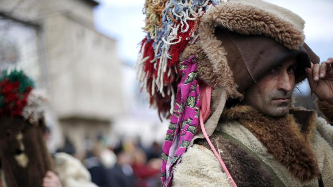 "Men dressed in costumes made of animal fur, known as ""kukeri"", participate in the International Festival of the Masquerade Games in the town of Pernik"