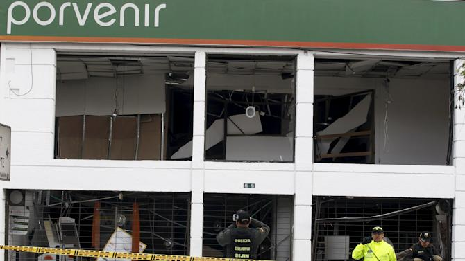 Policemen work the scene where an explosion occurred at the office of the Porvenir pension fund in downtown Bogota