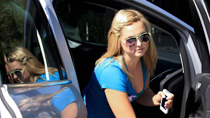 FILE - In this Thursday, Aug. 15, 2013 file photo, Hannah Anderson arrives at the Boll Weevil restaurant for a fundraiser in her honor to raise money for her family, in Lakeside, Calif. Hannah's mother, Christina Anderson, 44, whose body was found near the remains of her 8-year-old son at a family friend's rural house, died of a blunt injury to the head, the San Diego County Medical Examiner's Office said. Anderson, 44, was found dead Aug. 4 when firefighters extinguished flames at the home of James Lee DiMaggio, who is accused of murdering her and her son and kidnapping her 16-year-old daughter Hannah. DiMaggio was killed six days later in an FBI shootout in the Idaho wilderness. Hannah Anderson was rescued and returned to California. (AP Photo/U-T San Diego, Howard Lipin, File)