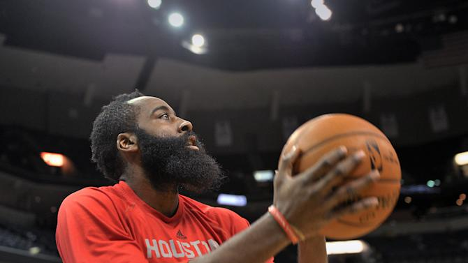 Houston Rockets guard James Harden warms up before the Rockets' NBA basketball game against the Memphis Grizzlies, Friday, Dec. 26, 2014, in Memphis, Tenn. (AP Photo/Brandon Dill)