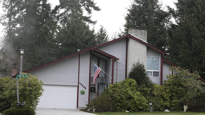 """The house where the bodies of an elderly couple were found Saturday, March 9, 2013, is shown Monday, March 11, 2013, in Renton, Wash. Washington state authorities are looking for Michael """"Chad"""" Boysen, accused of killing the couple, who are his grandparents, in Renton, Wash., just hours after he was released from prison. (AP Photo/Ted S. Warren)"""