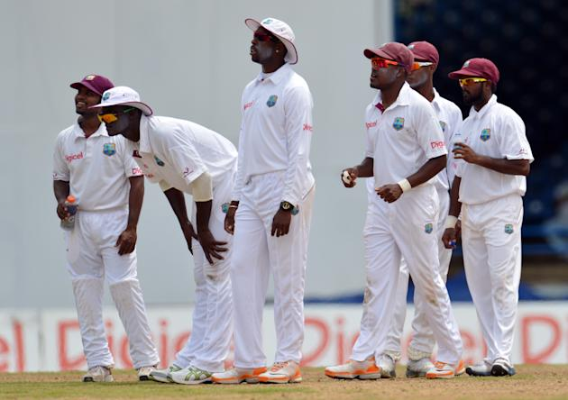 West Indies team waits for lbw review ag