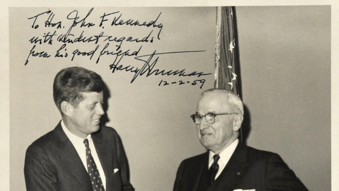 FILE - This undated file photo provided by John McInnis Auctioneers shows a photograph of late Presidents John F. Kennedy, left, and Harry Truman, signed by Truman on Dec. 2, 1959. The photograph is part of a collection of John F. Kennedy memorabilia from the family of David Powers, a former special assistant to the president, that fetched almost $2 million at auction Sunday, Feb. 17, 2013 at John McInnis Auctioneers in Amesbury, Mass. (AP Photo/John McInnis Auctioneers, File)