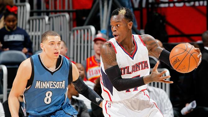 Atlanta Hawks' Dennis Schroder (R) and Minnesota Timberwolves' Zach LaVine during their at Philips Arena on January 25, 2015